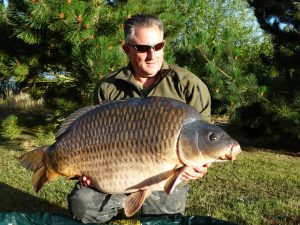 Biggest common carp - Chris Caddick displays the giant.