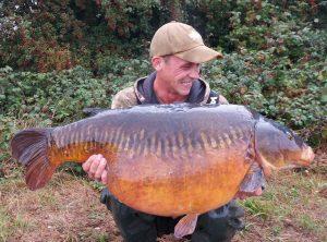 What a River Thames carp! Ash Geden admires his 44lb 14oz linear.