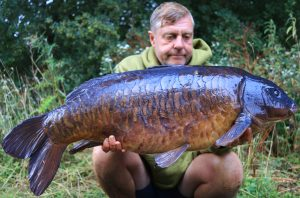 Urban Bait boss Terry Dempsey with one of the star catches from his year. He never managed to catch a 'dragon' ...but put up a good effort.