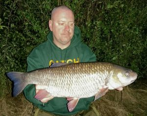 Stewart Barnes admires his giant Great Ouse chub.