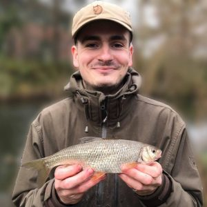 George Sharp displays his giant dace.