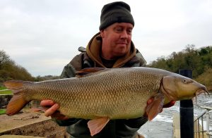 Liam Willis displays his biggest River Trent barbel