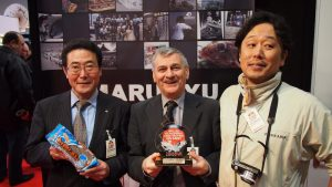 Happier times for Marukyu, when former UK chief John Loftus (centre) led them to awards here.