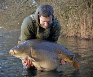 Neill Stephen admires his first-ever 60 lb carp before releasing it at Wellington Country Park.