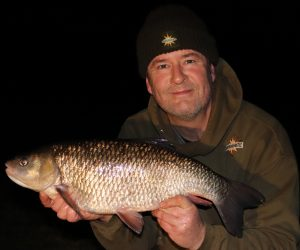 Specimen fishing ace Tony Gibson poses with his new PB chub of 7 lb 13 oz.