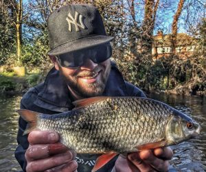 Urban gem - Ashley Bennett admires his big River Wandle roach.