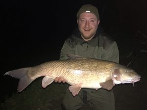 Ryan Pevy's giant Thames barbel scaled 19 lb 15 oz. He was a winner in Angler's Mail's famous Fish of the Week, sponsored by Richworth.