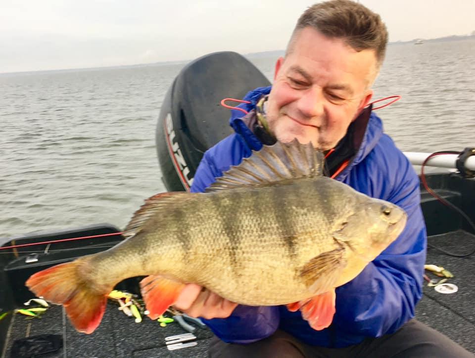Darren Starkey admires his 6 lb 1 oz perch. Read Darren's new column in Angler's Mail magazine.