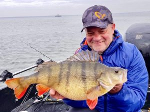 Darren Starkey shows his 6 lb 5 oz perch. he's just started a new regular column in Angler's Mail magazine where he'll explain all about his species hunting exploits.