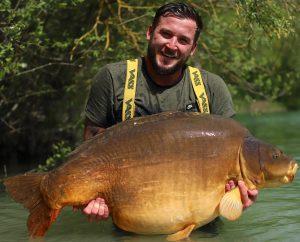 Sussex carper Luke Cornelius cradles his 81 lb 12 oz Gigantica giant.