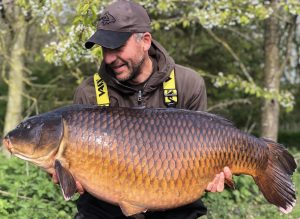 Simon Crow admires the stunning 53 lb 4 oz common carp, one of the UK's most admired fish.