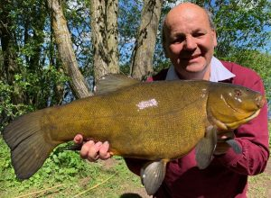 Tenchfishers member Cliff shows his 11 lb 8 oz tench, the highlight of a fish-in.