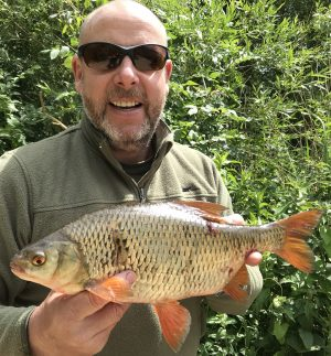 Lee Cowen shows the biggest of his Oxlease roach, scaling 3 lb 2 oz.
