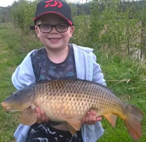 Despite the fishing tackle theft, young Archie was back fishing and he landed this lumpy carp.