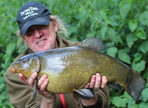the impressive tench caught by Iron Maiden star Adrian Smith.