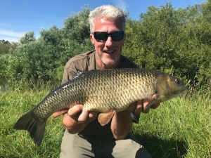 Magician David shows his 7 lb 7 oz chub.
