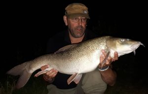 What a fishing birthday gift - John Mott displays his 16 lb 4 oz barbel. It was the heaviest barbel in an epic catch.