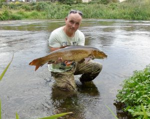 Fifth time lucky - James and his big Royalty Fishery barbel.