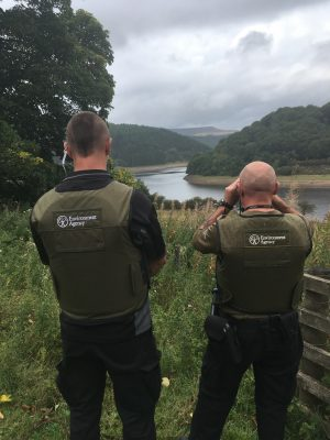 They're watching - an Environment Agency bailiff caught rogues hiding in bushes.