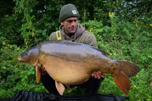 Scott Maslen admires his giant mirror carp before returning it to the Kent lake.