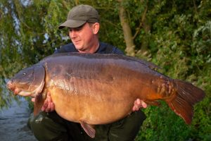 Ian Bailey with the Grenville Lake giant at 65 lb 12 oz.