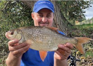 Mark Doherty shows the biggest fish of his River Wye roach haul.