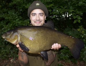 Matt Fernandez, seem in happier times with a giant tench, before the tackle theft near the River Itchen.
