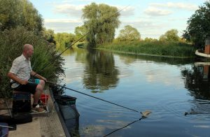 River pollution scene - Mail correspondent Tom Legge fishes at Baits Bite on the River Cam.