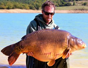 France carp joy - Wayne Barling admires his winter 64-pounder.
