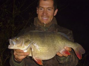 Neill Stephen holds the British record perch that he caught in 2011.