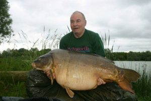 Bob Baker caught many specimen fish, especially carp. This 85 lb giant was landed at Graviers in France.