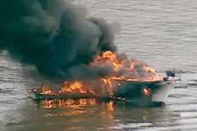 Motor cruiser set on fire by barbecue