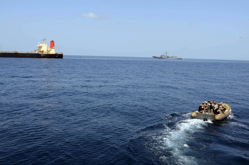 A US Navy RIB bears down on a tanker | Best boating pictures | Motor Boat Monthly
