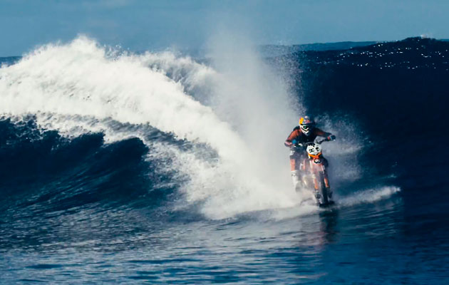 Robbie Maddison pipe dream Motorbike surfs wave in Tahiti