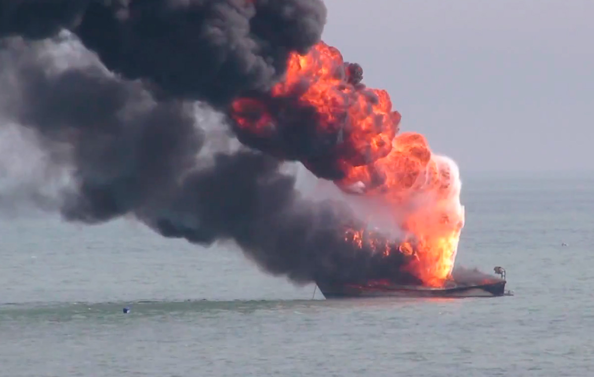 Burning boat off Eastbourne