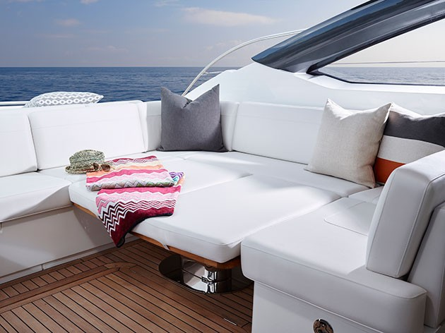 Princess V58 - cockpit table converts into an extra sunpad
