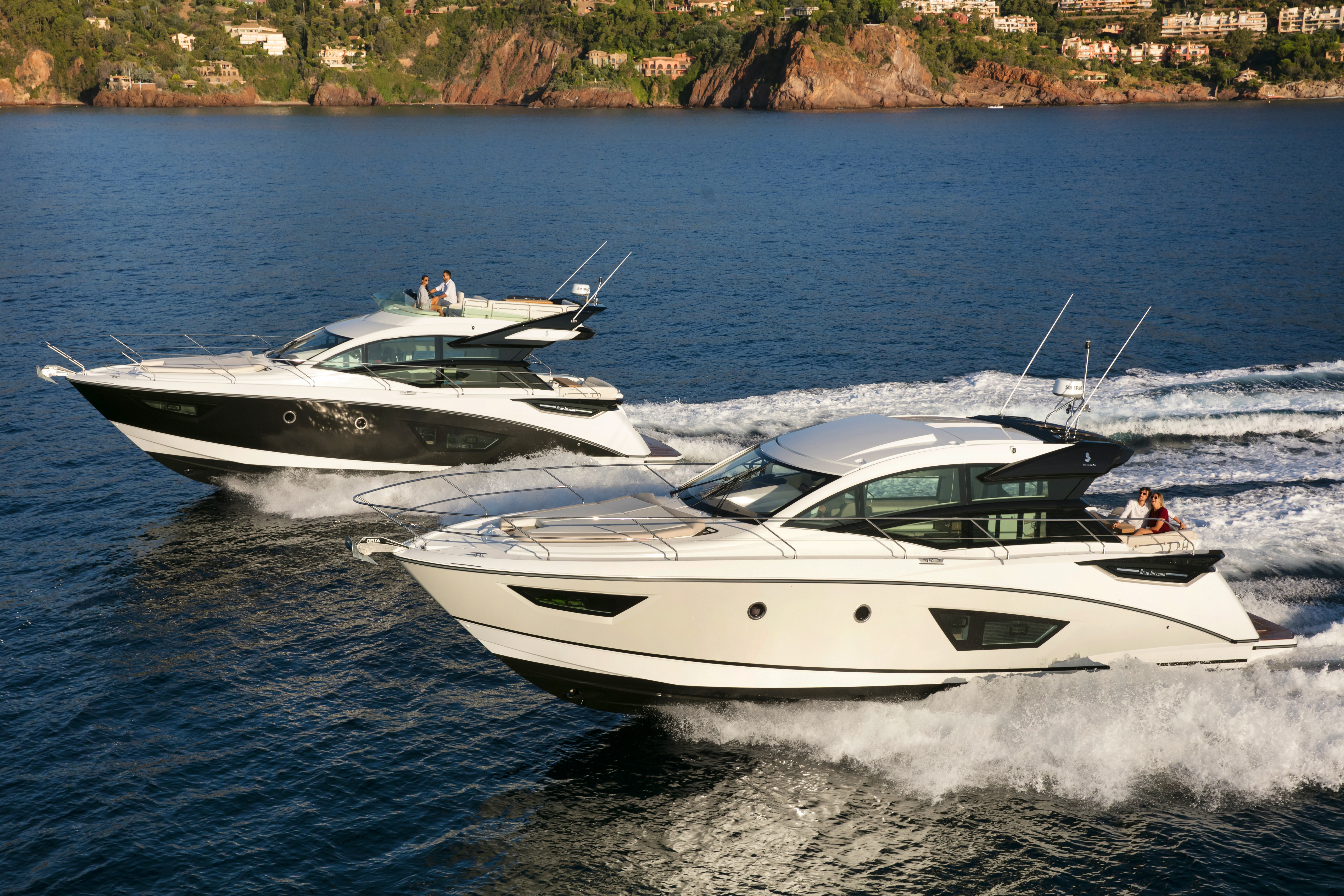 Beneteau GT50 Coupe and Sportfly on water