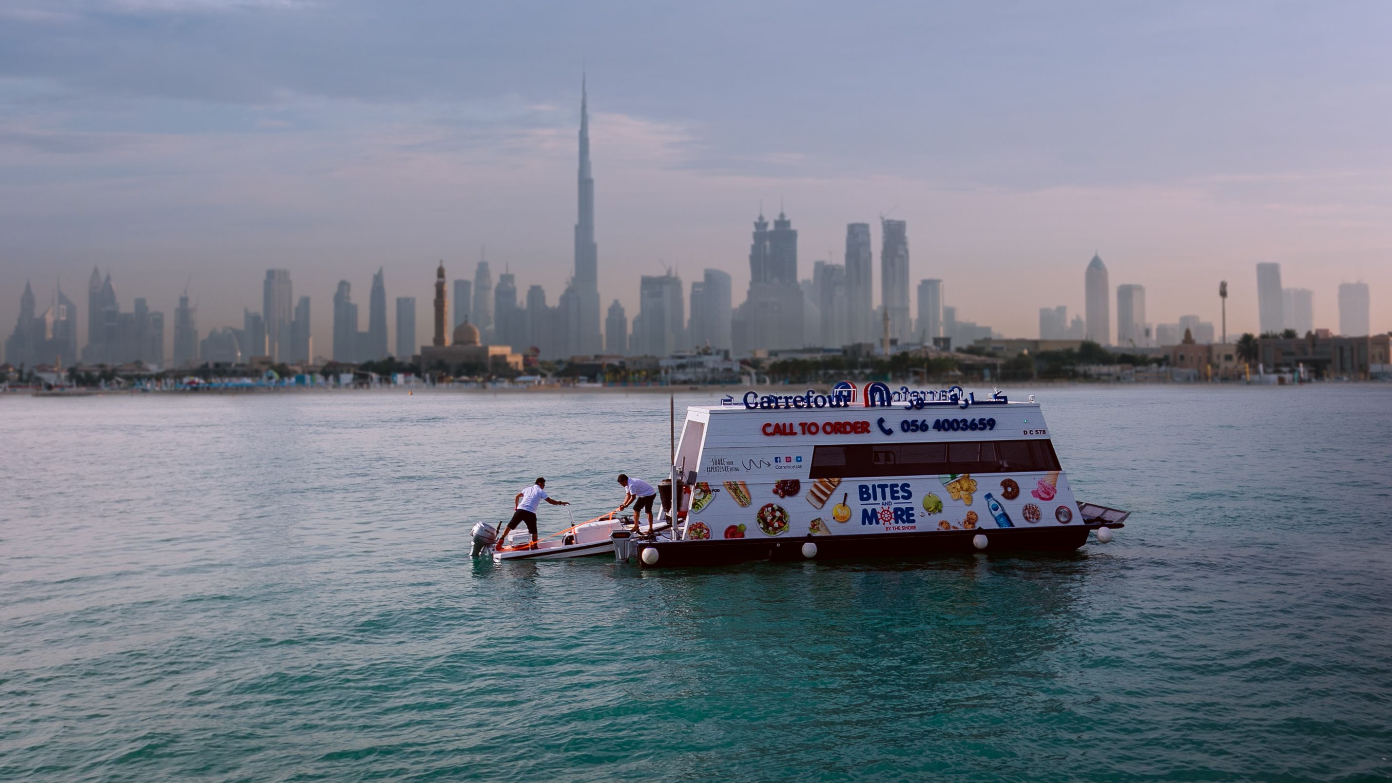Carrefour Aqua Pod against the Burj Khalifa skyline