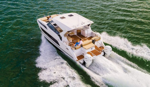 The 14ft beam makes for a very spacious cockpit while twin outboards give 37 knots