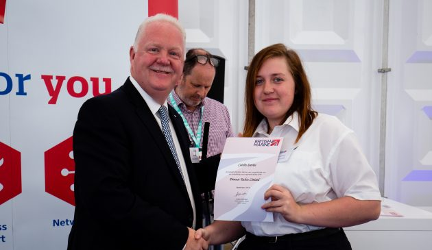 Apprentice Caitlin Davies at her graduation with former Princess Yachts Managing Director Chris Gates