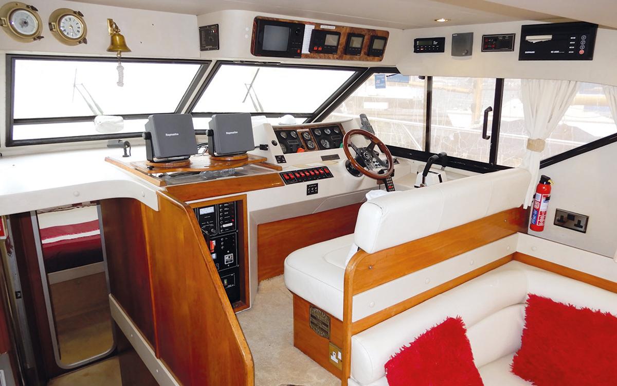best-40ft-flybridge-yacht-for-sale-princess-388-helm