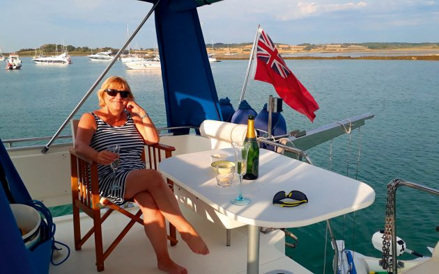 Jackie relishing a glass or two of fizz during an evening in Newtown Creek, the Isle of Wight. Words and photos: Kelston and Jackie Tobin.