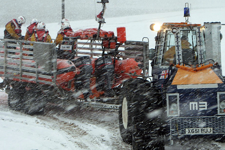 RNLI lifeboat launch from tractor in snow