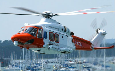 Coastguard helicopter over marina