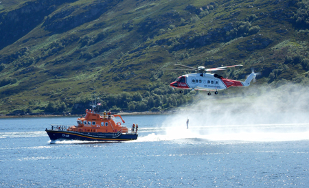 RNLI Lochinver lifeboat with Coastguard helicopter