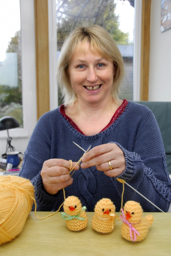 Pip Rowntree knitting her Easter chicks. Credit RNLI/Dave Barry