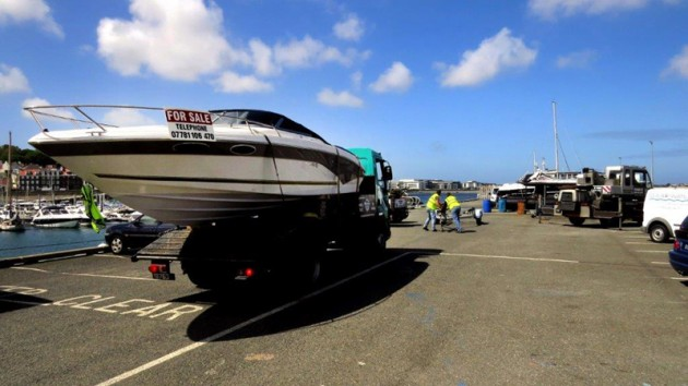 Moving a boat to St Peter Port, Guernsey on the back of a lorry 07-05-14 Pic by Tony Rive.jpg
