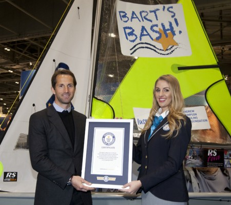 Sir Ben Ainslie one of the founding trustees of the Andrew Simpson Sailing Foundation accepts the certificate from Guinness World Record adjudicator Elizabeth Smith at a ceremony at the CWM FX London Boat Show