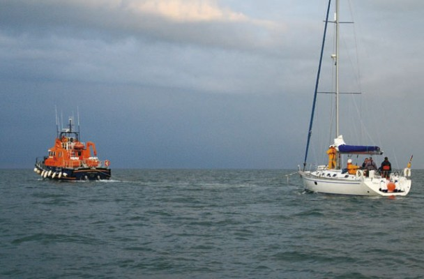 Lifeboat towing yacht