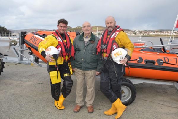 RNLI crew members Greg Donald and Pete Hughes with David Stocks